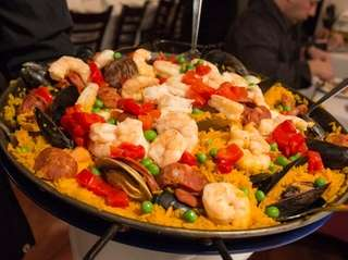 Sangria 71 serves paella Valenciana, the Spanish restaurant's
