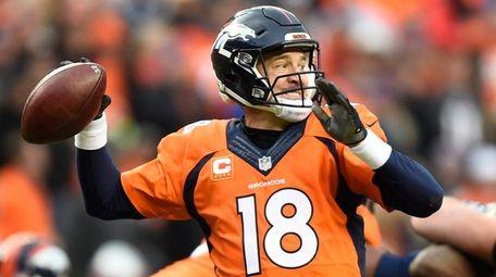 Denver Broncos quarterback Peyton Manning passes the