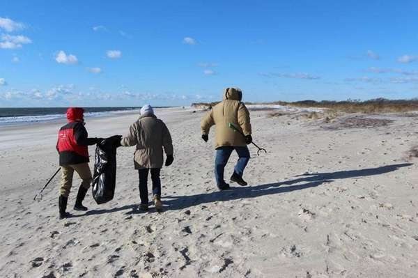 Participants walk the beach on Fire Island during