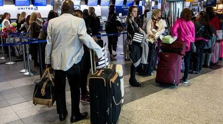Holiday travelers wait at LaGuardia Airport on Nov.