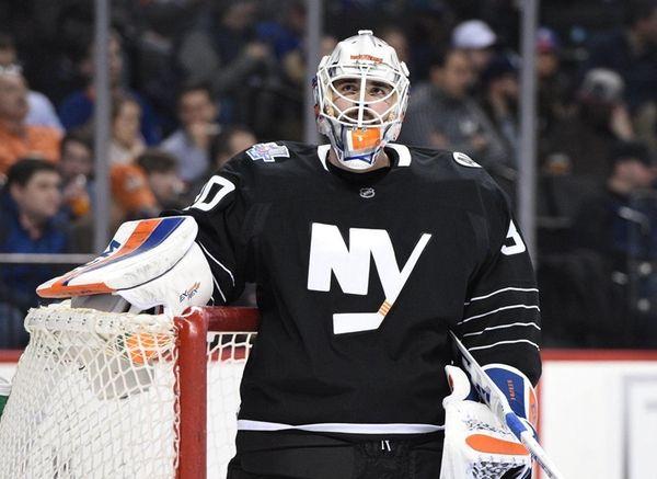 New York Islanders goalie Jean-Francois Berube looks