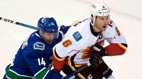 In this April 15, 2015 photo, Vancouver Canucks