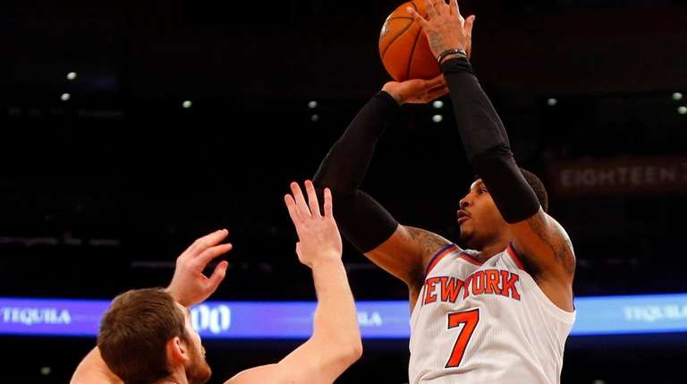 Carmelo Anthony shoots over Tyler Zeller of the
