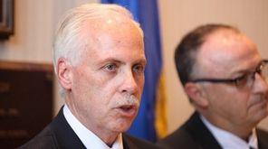 Suffolk County Legislator Kevin McCaffrey speaks beside