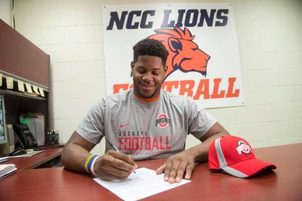 Nassau CC football standout Malcom Pridgeon signs his