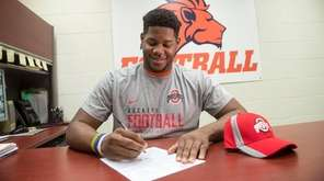 Nassau CC football standout Malcom Pridgeon signs his