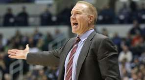 St. John's head coach Chris Mullin gives instructions