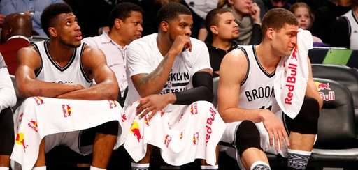 From left, Nets' Thaddeus Young, Joe Johnson and