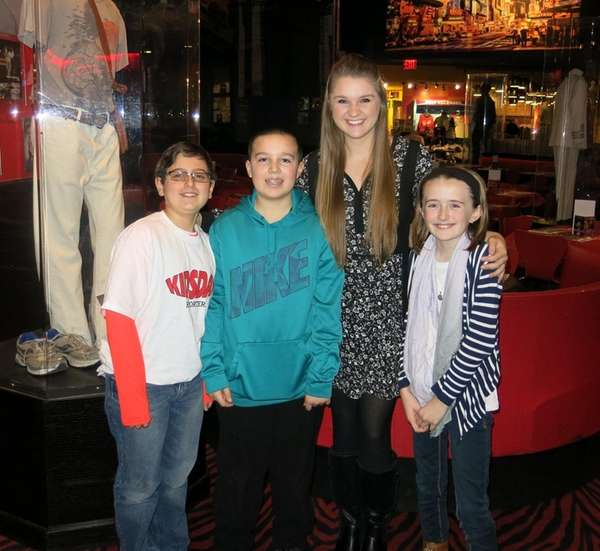 Singer Lizzie Sider with Kidsday reporters from left,