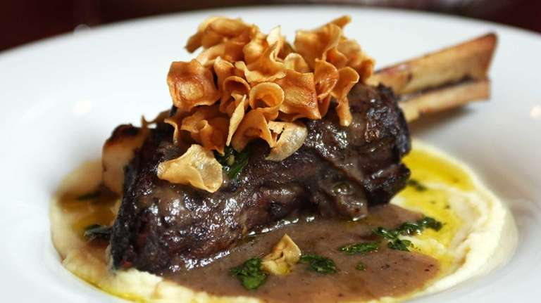 Lamb shank with parsnip puree is served at