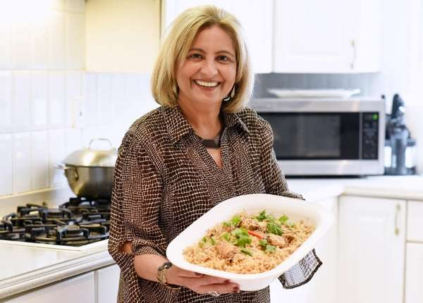 Nora Salimi of Westbury presents a platter of