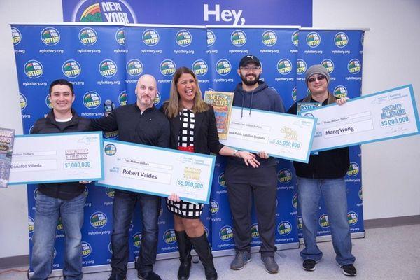 Lottery winners, from left, Wil Donaldo Villeda, Robert