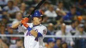 New York Mets shortstop Wilmer Flores waits for