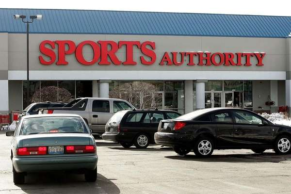 Vehicles parked outside a Sports Authority store Jan.