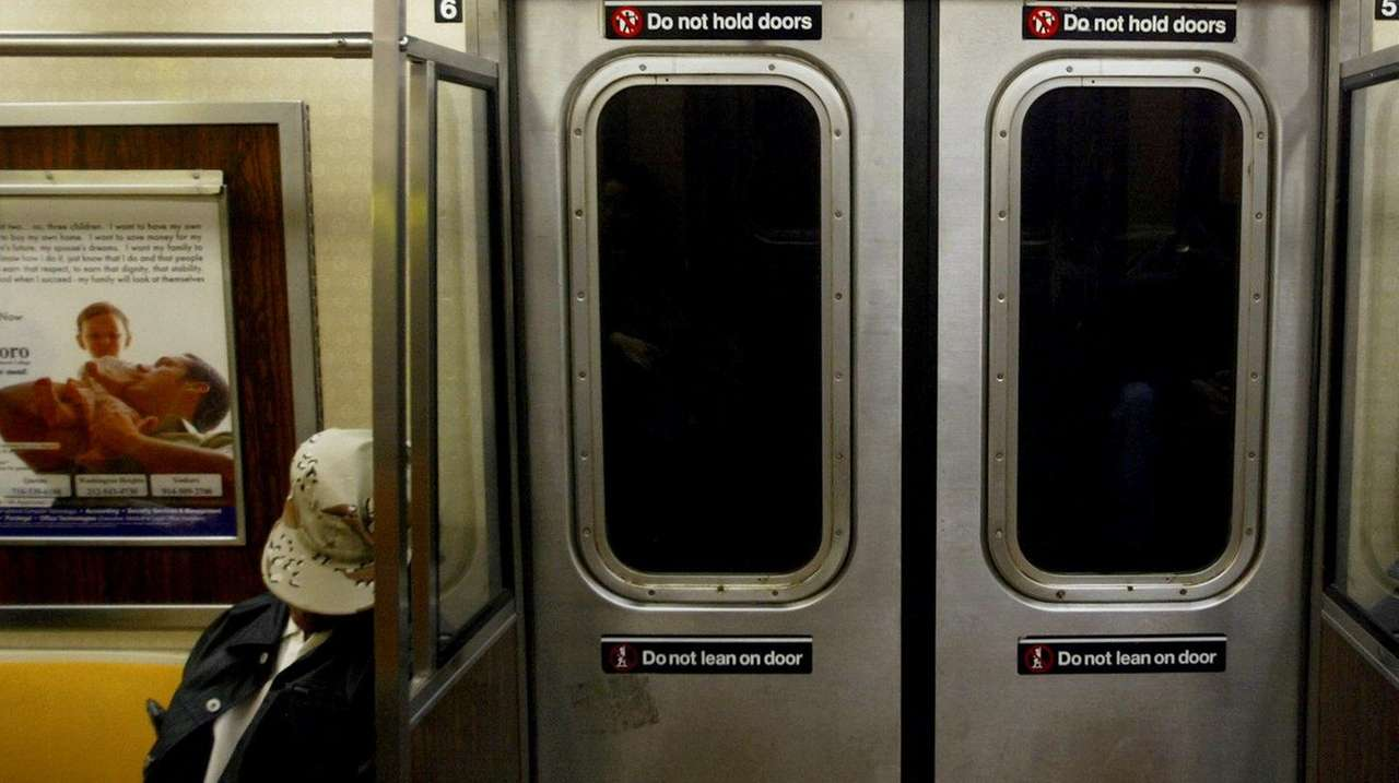 A New York City subway rider dozes on