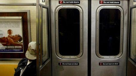 A New York City subway rider dozes on