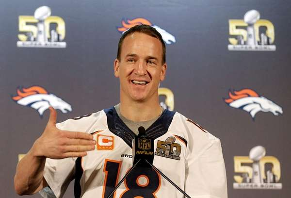 Denver Broncos quarterback Peyton Manning speaks to