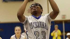 Riverhead's Faith Johnson-DeSilvia shoots the jumper in the