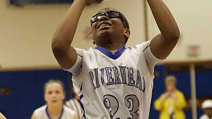 Riverhead's Faith Johnson-DeSilvia shoots the jumper in the