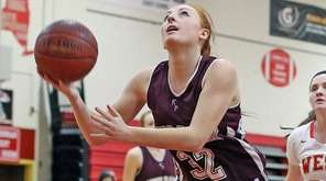 Kings Park's Tiffany Slicklein shoots under the basket