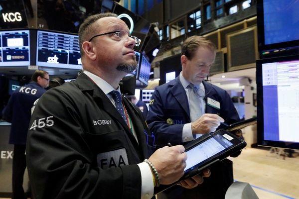 Traders Robert Arciero, left, and Michael Smyth watched