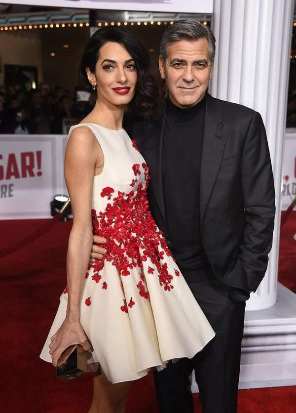 Amal Clooney and actor George Clooney attend Universal