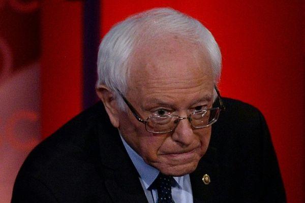 Democratic presidential candidate Bernie Sanders listens as