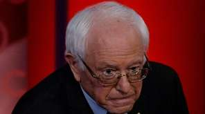 Democratic presidential candidate Bernie Sanders listens as