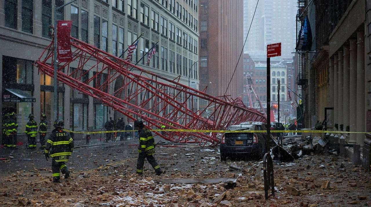 FDNY firefighters at the scene of a crane