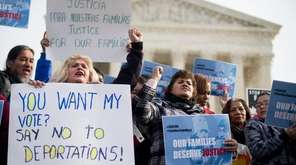 Immigration advocates rally outside the Supreme Court