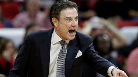 Louisville coach Rick Pitino yells during the