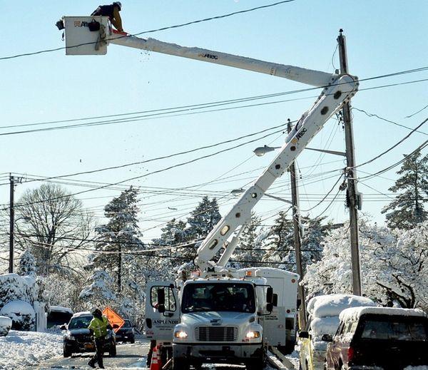 Line crew contractors work on power lines on