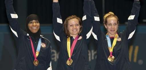 Ibtihaj Muhammad, Dagmara Wozniak and Mariel Zagunis of