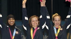 Ibtihaj Muhammad, Dagmara Wozniak and Mariel Zagunis of