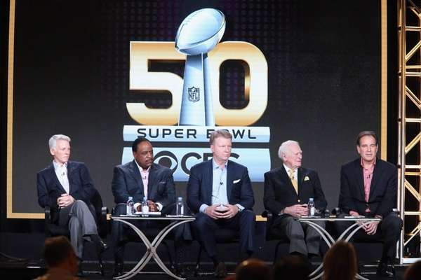 From left, Sean McManus, James Brown, Phil Simms,