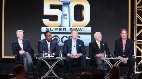From left, Sean McManus, James Brown, Phil Simms,