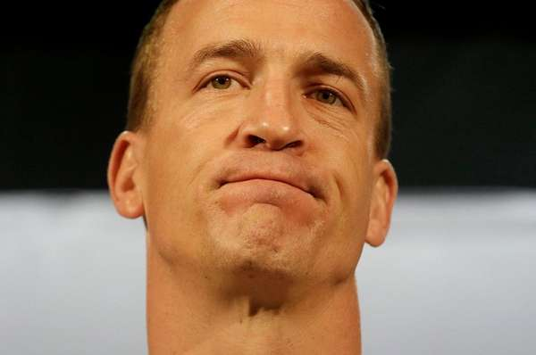 Denver Broncos quarterback Peyton Manning speaks to