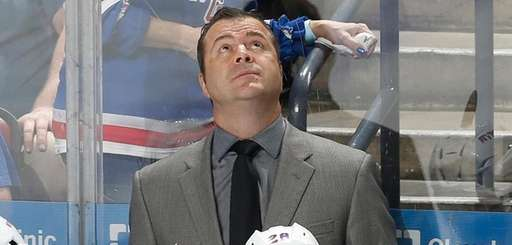 New York Rangers head coach Alain Vigneault watches