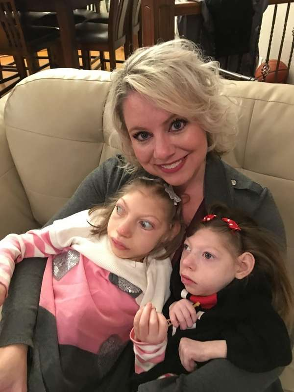 Gwen Hartley and her two daughters, Claire 14,