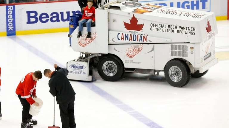 Crews repair the ice at Joe Louis Arena