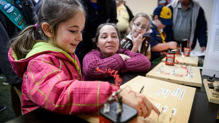 Cara Campbell, 5, of Levittown, learns about electricity