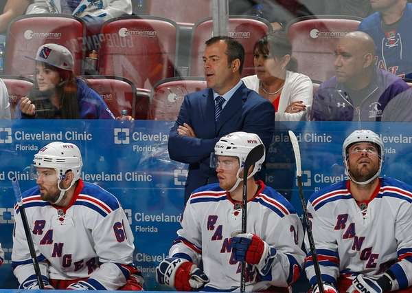 New York Rangers coach Alain Vigneault looks on