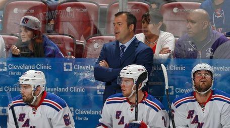 New York Rangers coach Alain Vigneault looks on