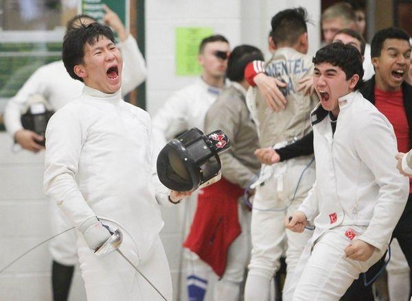 Half Hollow Hills Edward Bae celebrates his victory