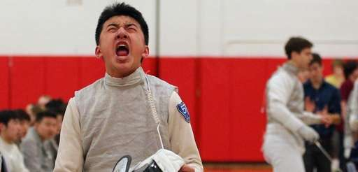 Jericho foil Chris Xu (left) reacts after defeating
