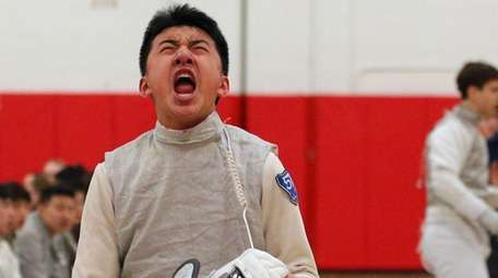 Jericho foil Chris Xu (left) reacts after defeating