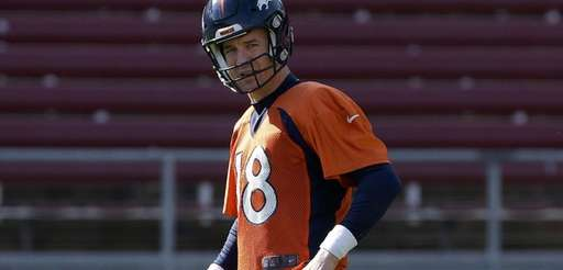 Denver Broncos quarterback Peyton Manning stands on the