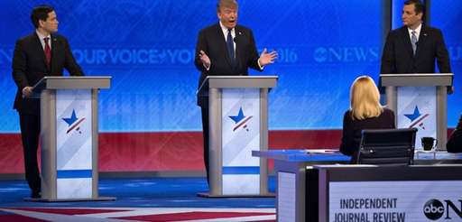Republican presidential candidate Donald Trump, center, speaks as