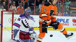 Philadelphia Flyers' Ryan White, right, leaps to let