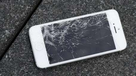 An Apple iPhone with a cracked screen after